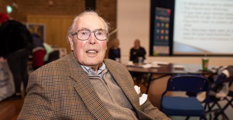 Older gentleman in a tweed jacket